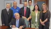 (PHOTO CAPTION) SCCC President, Dr. Paul Mazur (seated), signs The Degree Advantage Pledge with other faculty and staff pledge signers looking on. Standing from left to right; Frank Nocella, Vice President of Finance and Operations; John Kuntz, Director of Athletics / Assistant Dean of Students; William Waite, Interim Vice President of Academic Affairs; Peter Schoch, Interim Dean of Business, Math, Science and Law; Debbie McFadden, Dean of Student Affairs; Dr. Kathleen Okay, Interim Dean of Liberal Arts, Social Science and Education.