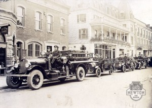 An historic photo in front of the Spring Street Firehouse, now the Newton Fire Museum. Photo courtesy of the Newton Fire Museum.