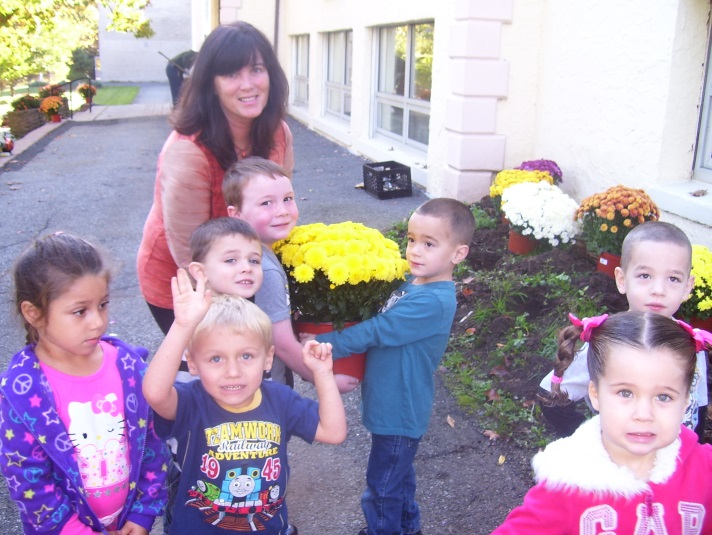 Preschoolers in Mrs. Gordon's class help with the planting activities.