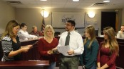 Photo by Scott Baker. David Fanale, new Franklin Borough Councilman, is sworn into the council by Franklin Borough Clerk Robin Hough (far left). Fanale's fiancee, Kerry Hodgson, holds the Bible, while Hodgson's daughters, Meghan and Kristen Sferlazzo (far right) look on.