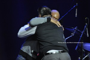 """Eliot Sloan of Blessid Union of Souls embraces Hap Rowan, after singing the song, """"I Believe,"""" onstage to Hap and his wife, Mary."""