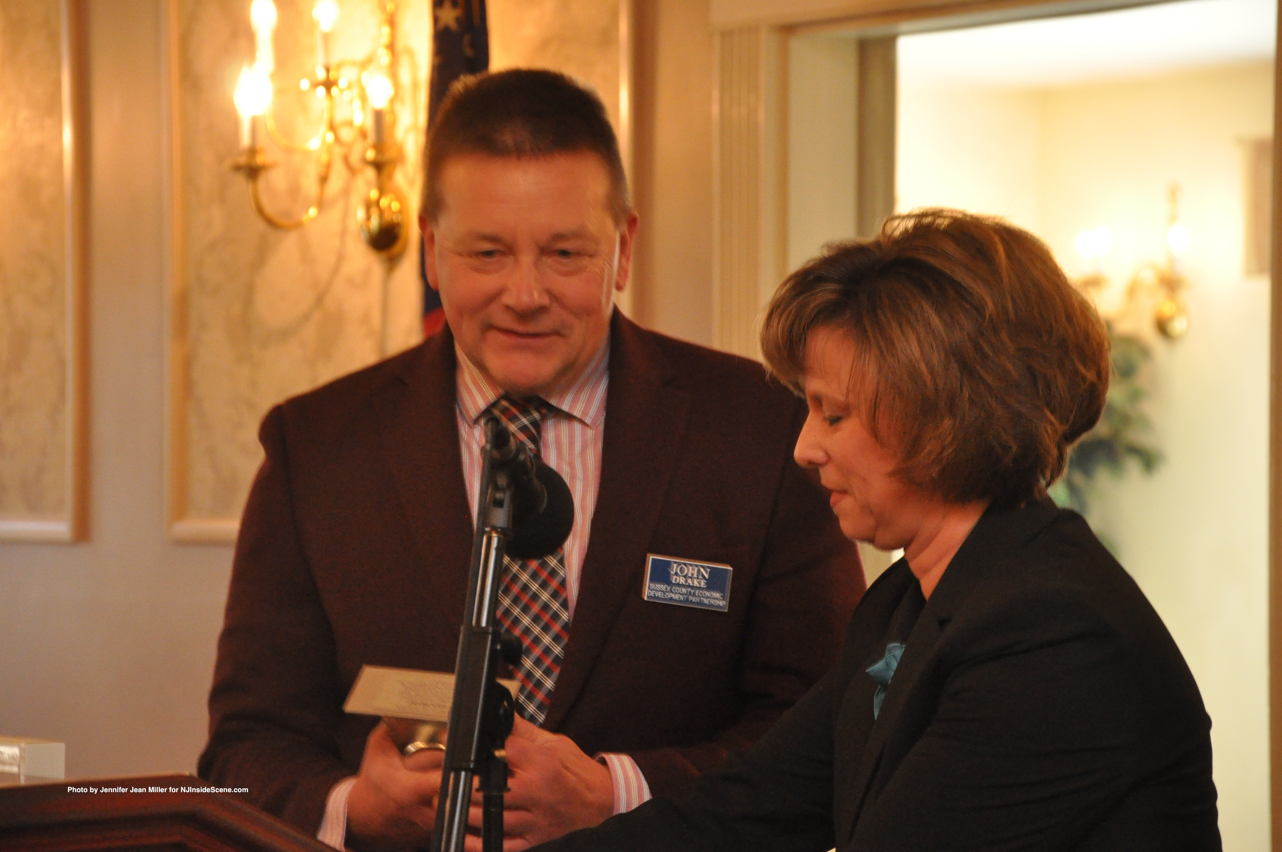 Tammie Horsfield President of the Sussex County Chamber of Commerce, and Economic Development Partnership, presents a special award to John Drake, for his advocacy to area businesses.