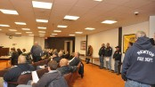 Members of the Newton Fire Department and the public, at the meeting on Monday night.