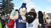 The mascots for the Krogh's Turkey Trot take a break from the festivities to strike a pose.