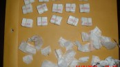 "150-bags of Heroin stamped ""JORDAN"" and numerous empty glassine bags thata re stamped ""ROSE"" along with a bloody tissue, these were some of the evidence seized during a search of a motor vehicle being driven by a Sussex Couple early Tuesday on Rte. 15. Both were charged with Possession of Heroin and other drug related charges. (Photo courtesy of the Sparta Twp. Police Dept.)."