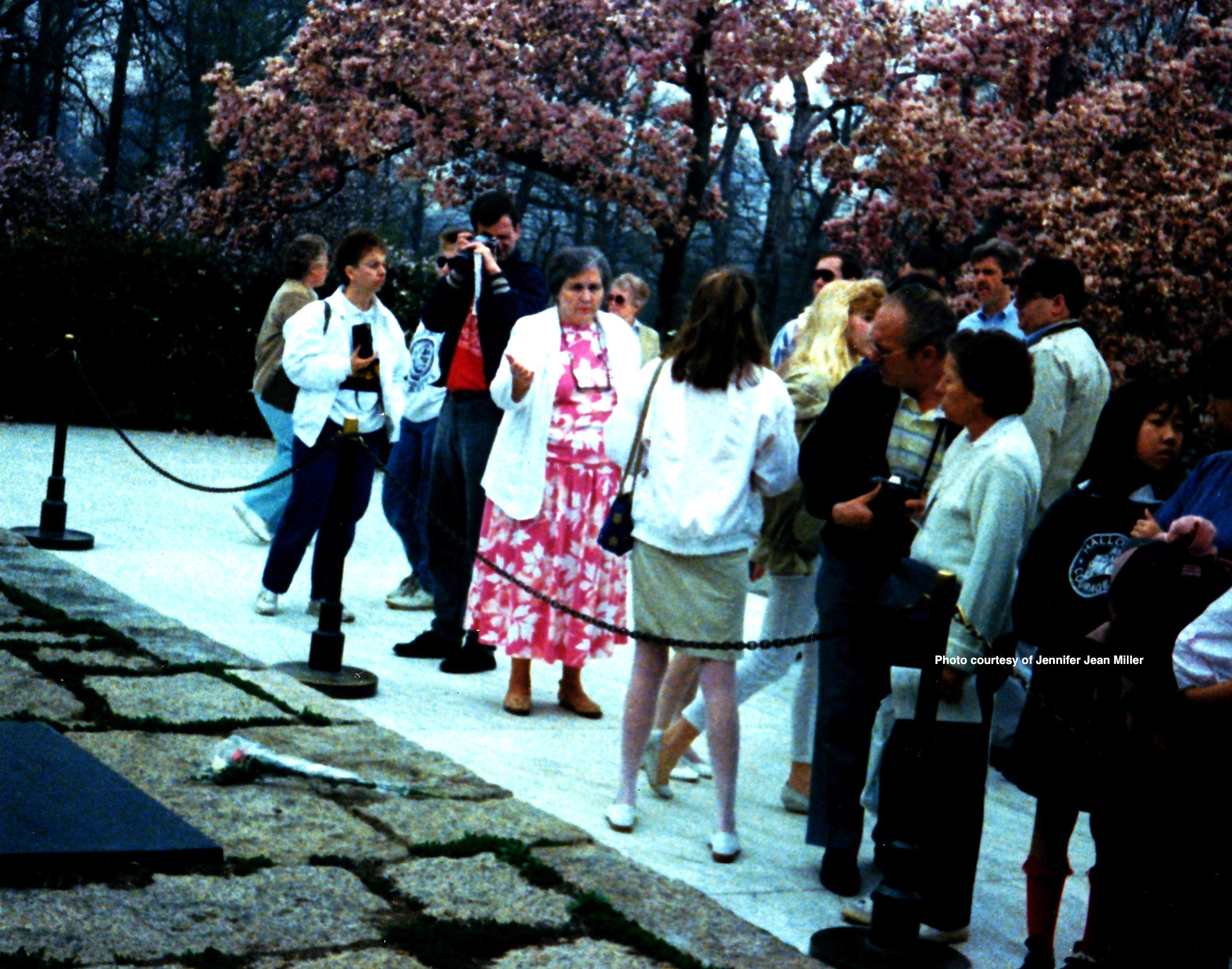 A blonde flash as the author of this story is photographed, after leaving a floral tribute on the grave of JFK. Photo courtesy of Jennifer Jean Miller.