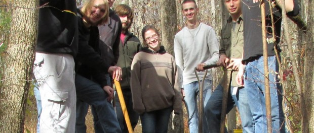 Students fill a rock crib frame with dirt and rock. From left to right; Michael Tyler, Ryan May, Joe Thompson, Brendon McKenna, Angela Lanham, Joe Ferraro, Rick Lisenby and Seth Simko. Not pictured are Paul Frangipane and Dan Hromnak