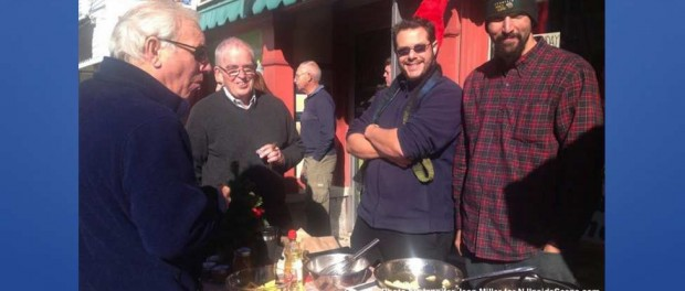 Jonathan Andrews of the Springboard Shoppes (far left), and visitors to the Newton Winter Farmers' Market, stop by the Jersey Barnfire Hot Sauce table for samples, with John Sauchelli (left) and Austin D-Almeida (right), the team that created the original sauce.