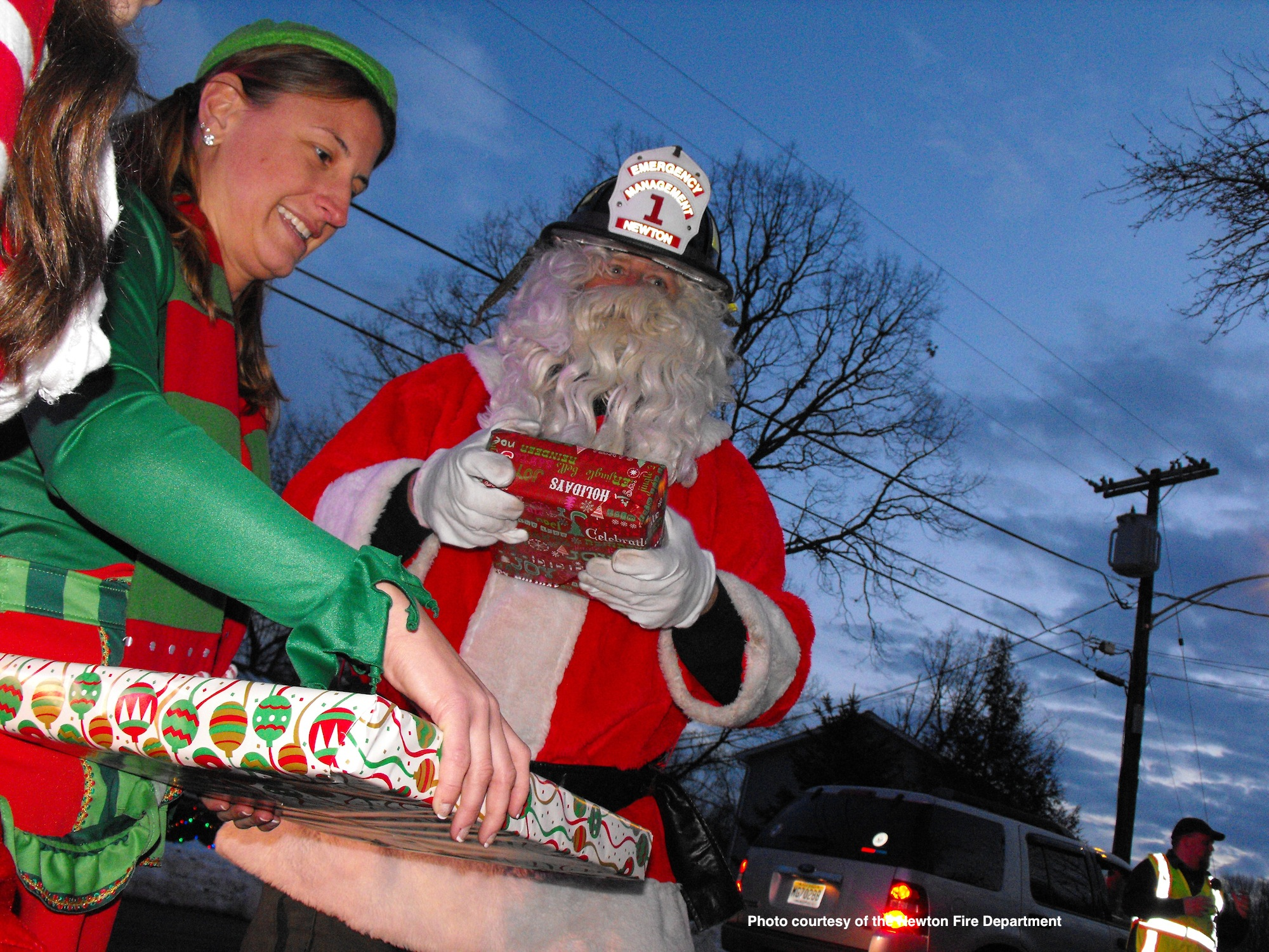 Dusk falls and work for Santa and his crew continues. Photo courtesy of the Newton Fire Department.