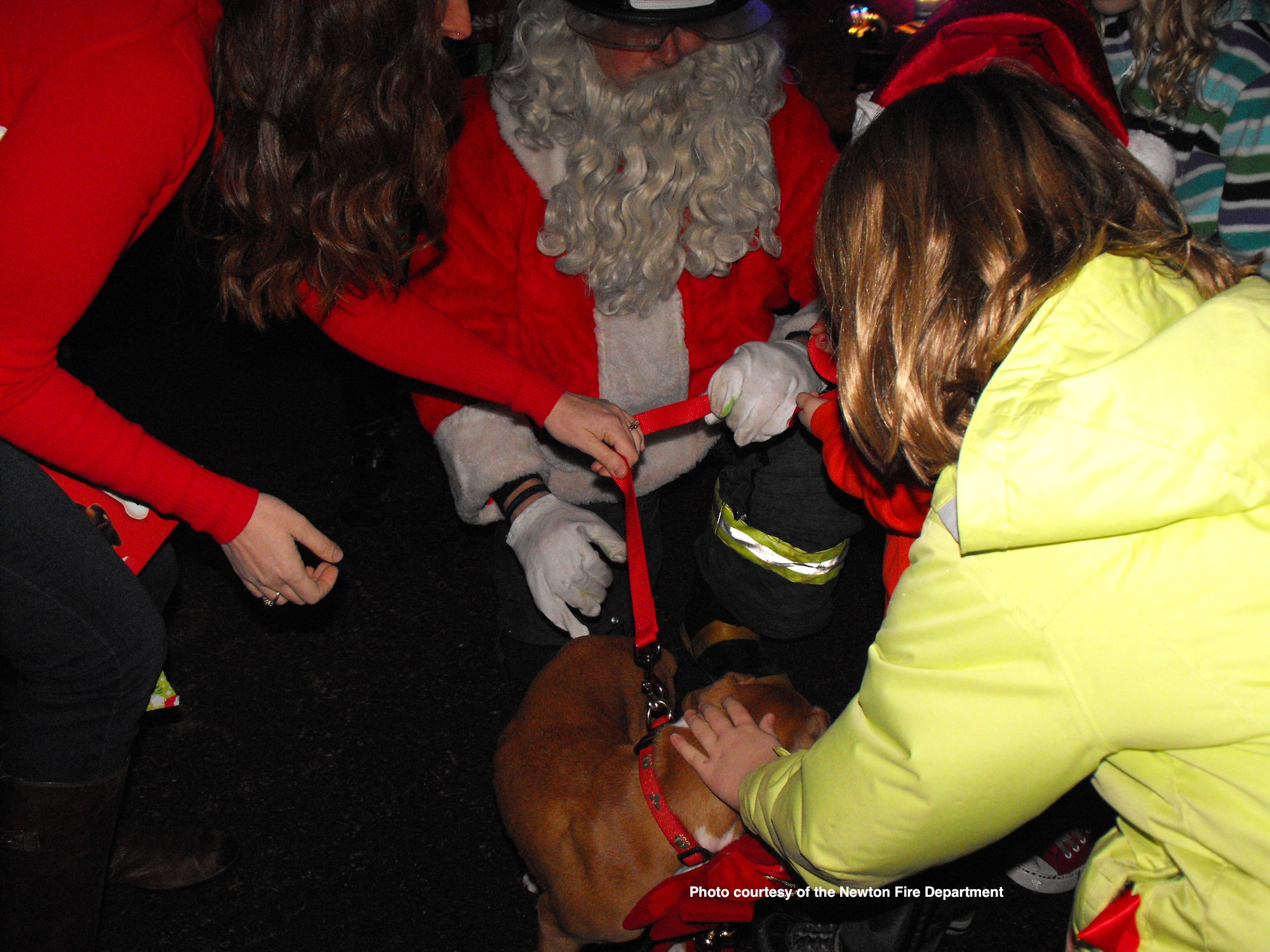 A boxer puppy being delivered by Santa to its new home. Photo courtesy of the Newton Fire Department.