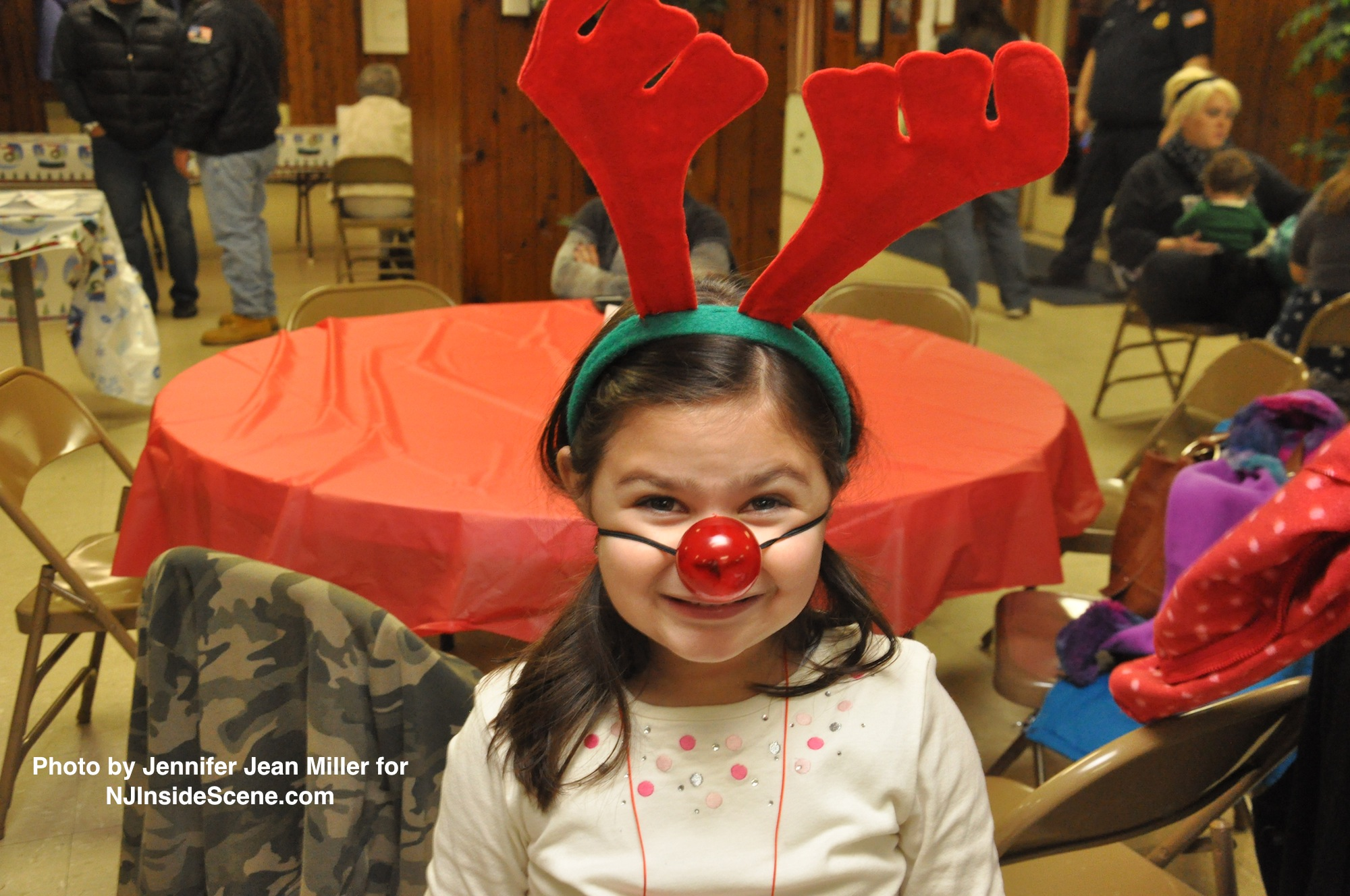Brianna Kash shows her holiday spirit with her Rudolph nose and antlers.