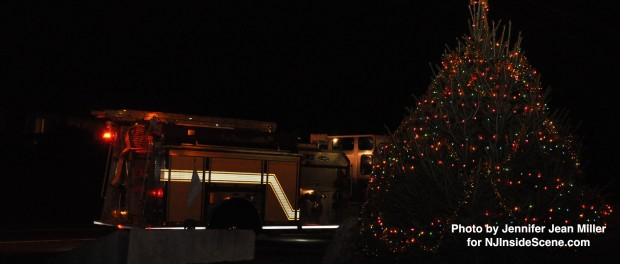 A Byram Township Fire Department Fire Truck parked alongside of the newly lit tree.