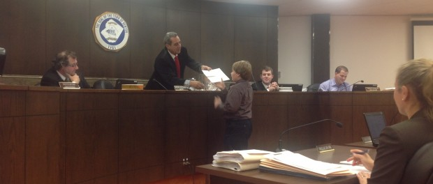 Mayor Joe Ricciardo awards Garrett Vanni for his holiday decorating efforts.