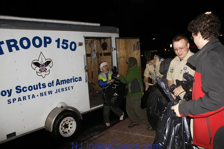 Scouts place items into the Troop 150 trailer. Photo courtesy of Boy Scout Troop 150.
