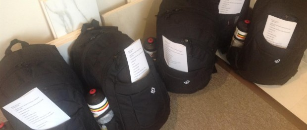 Six of the backpacks filled by volunteers at Sparta Trades Kitchens and Baths, which were distributed to area homeless veterans.