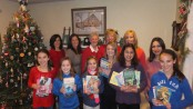 L-R, Back row: book volunteers Betsy Groome, Kelly Merwin, Karen Curd, Elaine Furfero, Erin Ryan, Vaishali Dhand; Front Row: Katie Groome, Kate Ryan, Kelly Groome, Kenzie Merwin, Raina Dhand and Corinne Groome hold some of the books collected to be donated to Newton Medical Center and other organizations