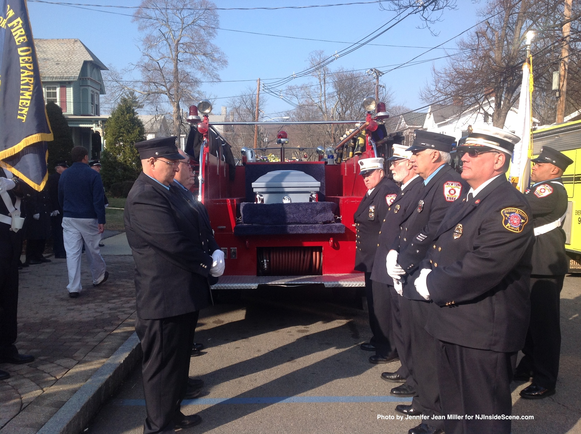 Firefighters who were pallbearers, placed Thom's coffin atop the Mack Fire Truck.
