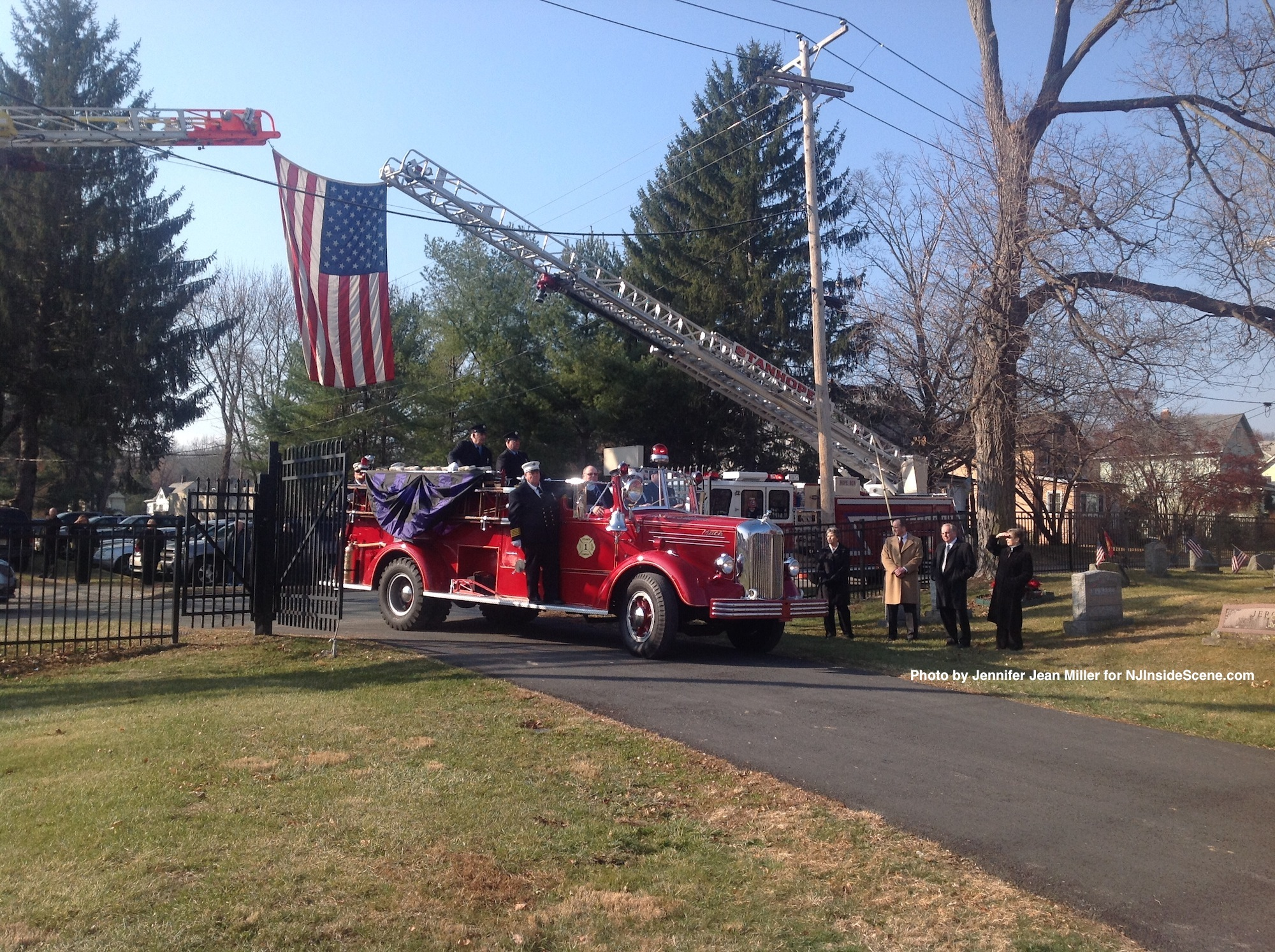 The antique fire engine delivers Charlie Thom's casket to its final resting place.