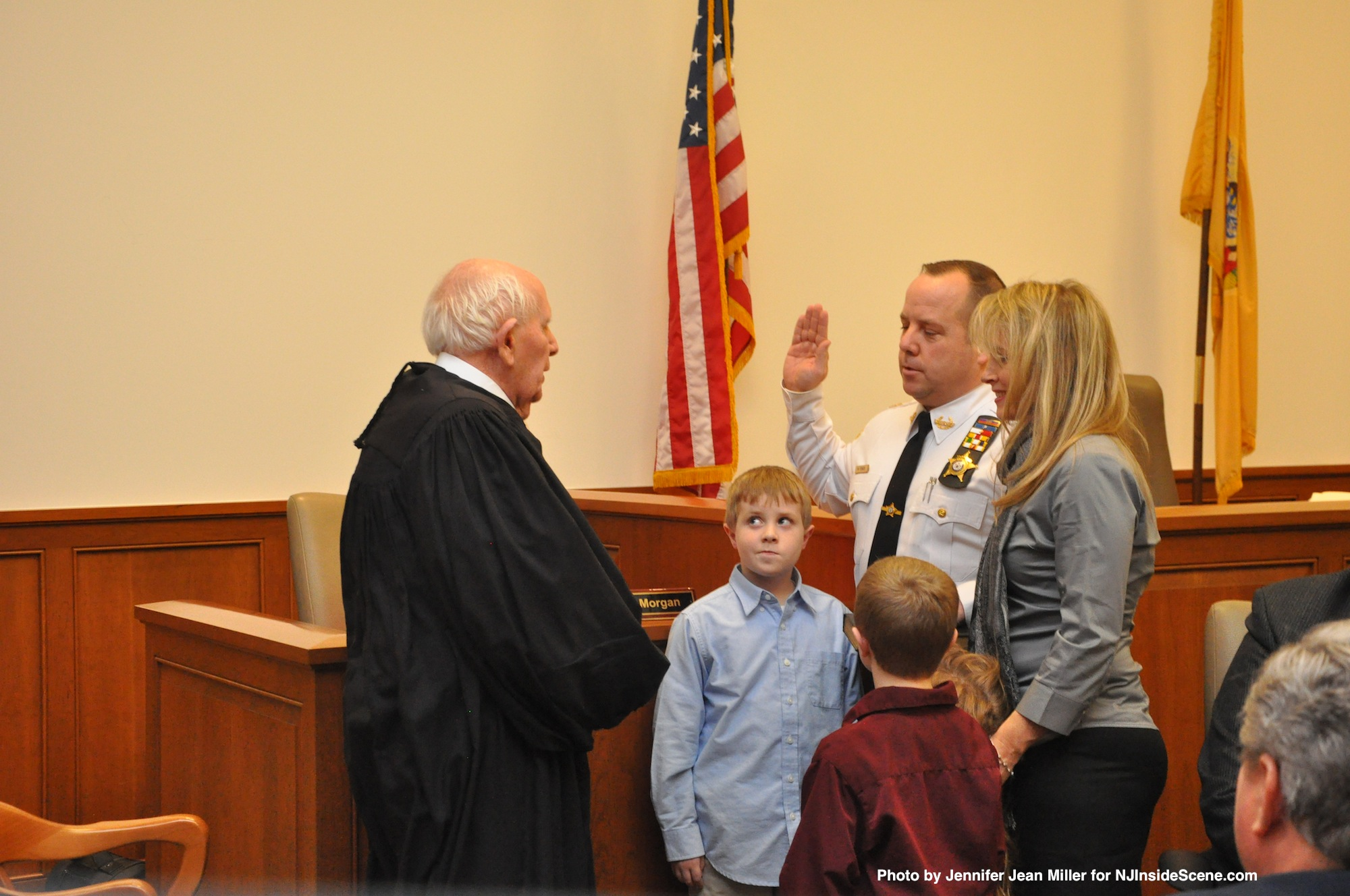 Sheriff Michael Strada, with his family, at the swearing in, with Judge Frederic Weber.