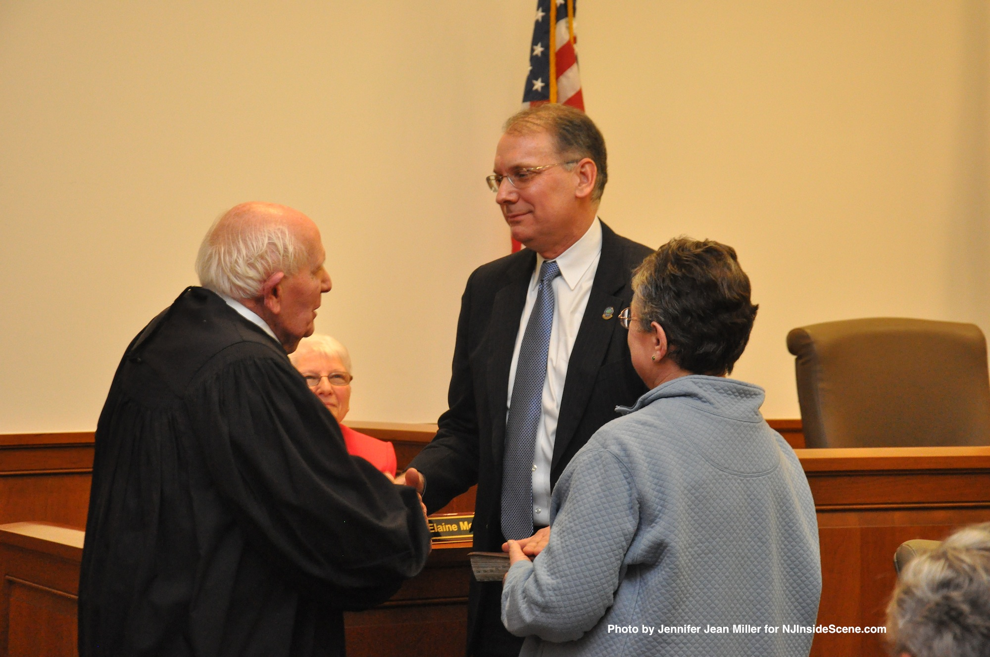 Dennis Mudrick, as he is sworn in as Deputy Director of the Sussex County Board of Chosen Freeholders, with his mother, Ann, and Judge Frederic Weber.