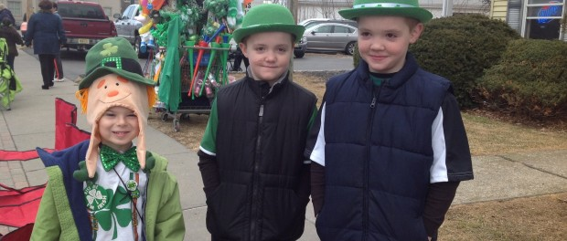 Three spirited Newton youngsters from left to right: Lucas Fox, age five, Jason Teets age eight and his brother Patrick Teets, also eight, are ready for the parade. Lucas and his mother passed out green fortune cookies to those they knew. Photo by Jennifer Jean Miller.