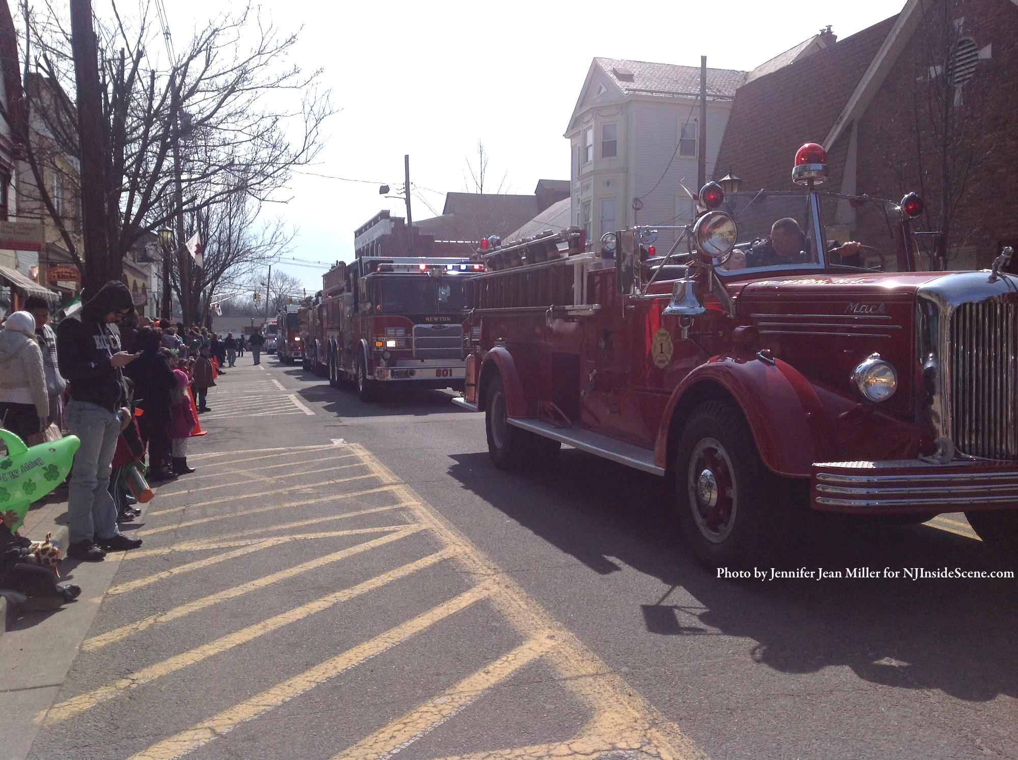 A line of firetrucks led by Newton's prized Mack, made their way down Spring Street. Photo by Jennifer Jean Miller.