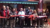 The ribbon is cut outside of the Springboard Shoppes.