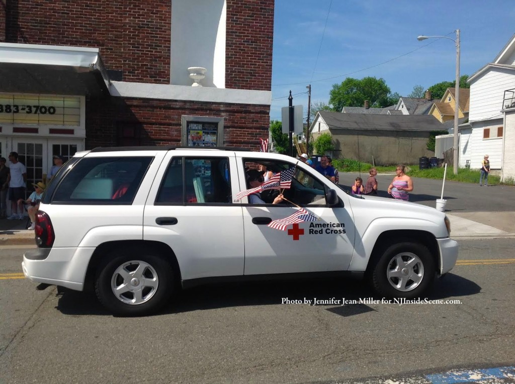 Members of the American Red Cross, Sussex County Chapter, wave flags from their vehicle. Photo by Jennifer Jean Miller.