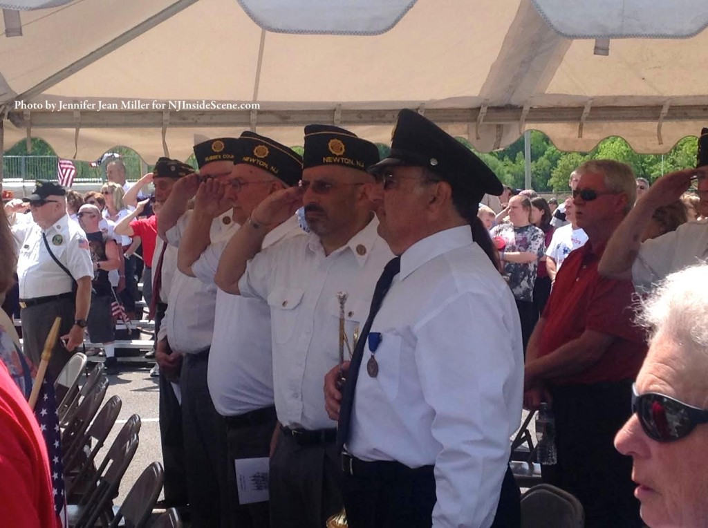 Veterans give a salute during the National Anthem. Photo by Jennifer Jean Miller.
