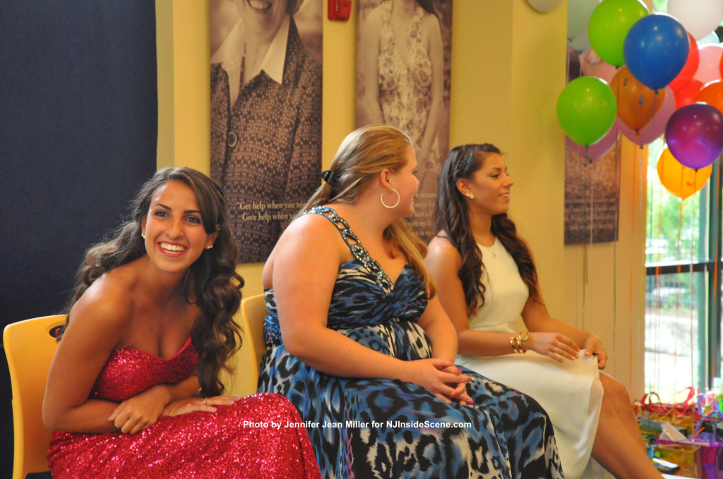 The three contestants for Miss Newton, from left to right: Petry, Mackenzie Kratzsch and Gina Emering, during the intermission. Little Miss Newton contestants spent time chatting with the Miss Newton contestants, stopping by to each of them with hugs. Photo by Jennifer Jean Miller.