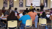 Local residents participate in an Enough Abuse Campaign training session.