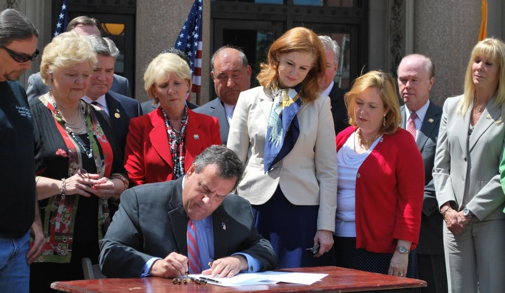 Governor Chris Christie signs the Jessica Lunsford Act into law.  Behind him from Left to Right:  Mark Lunsford, father of Jessica Lunsford, Senator Diane Allen (R-7), Senator Steve Oroho (R-24), Assemblywoman Mary Pat Angelini (R-11), Senator Chris Connors (R-9), Assemblywoman Nancy Munoz (R-21), Assemblywoman Alison Littell McHose (R-24), Assemblyman Pat Diegnan (D-18), and Assemblywoman Betty Lou DeCroce (R-26).