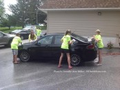 Wallkill Valley First Aid Squad cadets lather up a car during the group's fundraiser. Photo by Jennifer Jean Miller.