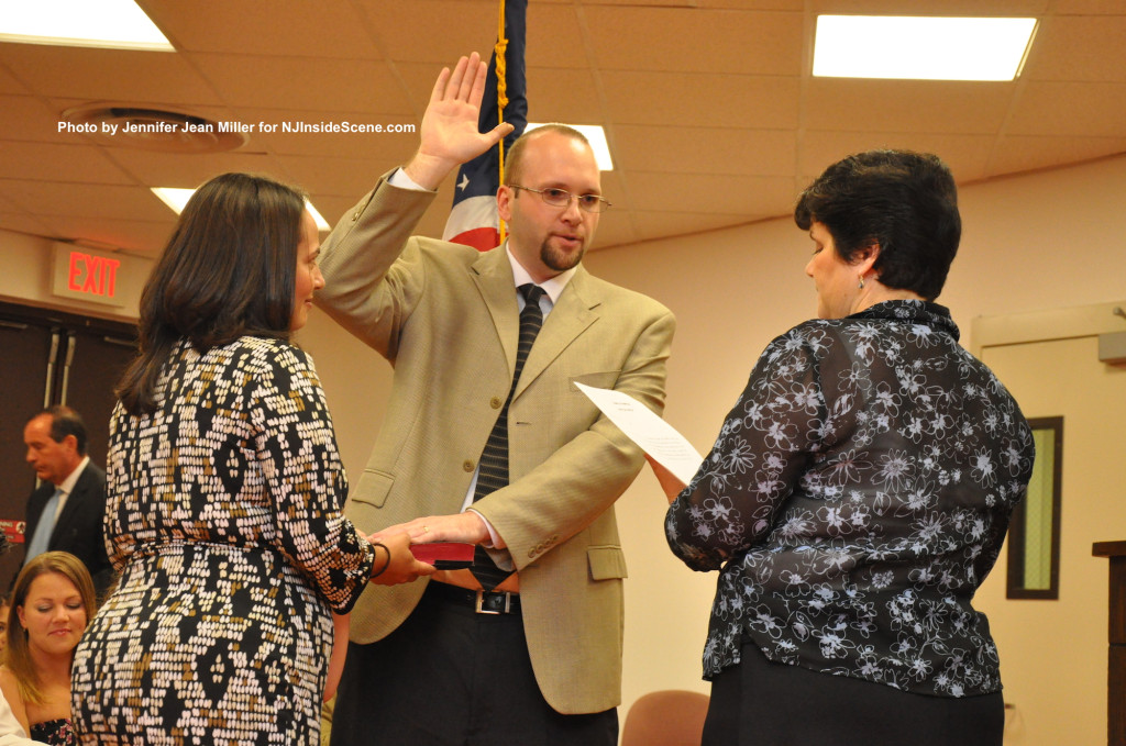 Town Clerk Lorraine Read swears in Wayne Levante as wife Damaris holds the Bible, with daughter Molly (hidden from view) between the two. Photo by Jennifer Jean Miller.