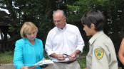 Lieutenant Governor Kim Guadagno (right), NJ DEP Commissioner Bob Martin (center) and Blanca Chevrestt the Superintendent of Swartswood State Park (right) review a map of the park that Chevrestt presented to Guadagno during her visit. Photo by Jennifer Jean Miller.