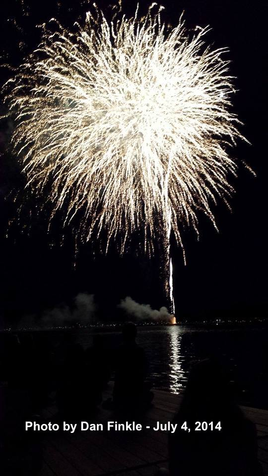 A view from Lake Mohawk's Beach One, as white fireworks reflect on the water. Photo courtesy of Dan Finkle.