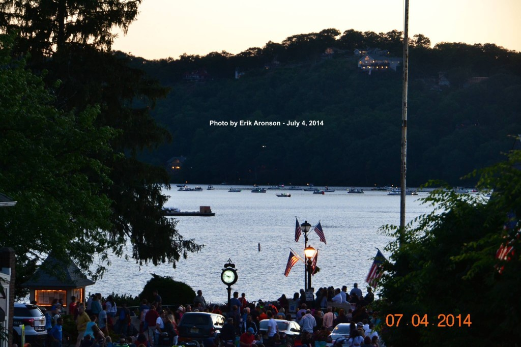 Dusk falls on Lake Mohawk, as the lights begin to glimmer and the crowd gathers. Photo courtesy of Erik Aronson.
