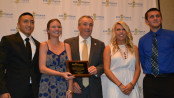 New Jersey Labor Commissioner Harold J. Wirths (center) holds a plaque commemorating his support for Kid's Chance New Jersey, which issued six scholarships, each for $10,000, to students who had a parent killed or catastrophically injured at work. Scholarship recipients included (from left to right) Pedro Morejon of Lyndhurst, Alexandra Kurnath and Mackenzie Kurnath of Seaside Park (formerly of Chester) and Scott Kwiatek of South Amboy. The two other scholarship recipients were Marie Molinaro of Rockaway and Trent Schamble of Vernon.