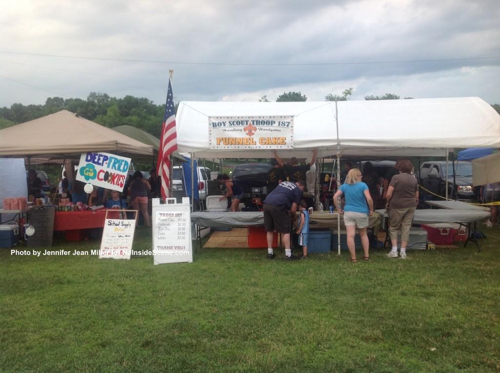 Side by side scouts selling some fair fare. Photo by Jennifer Jean Miller.