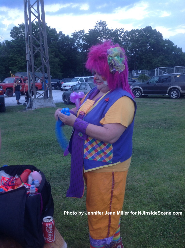 A clown delivers smiles and balloon art animals. Photo by Jennifer Jean Miller.