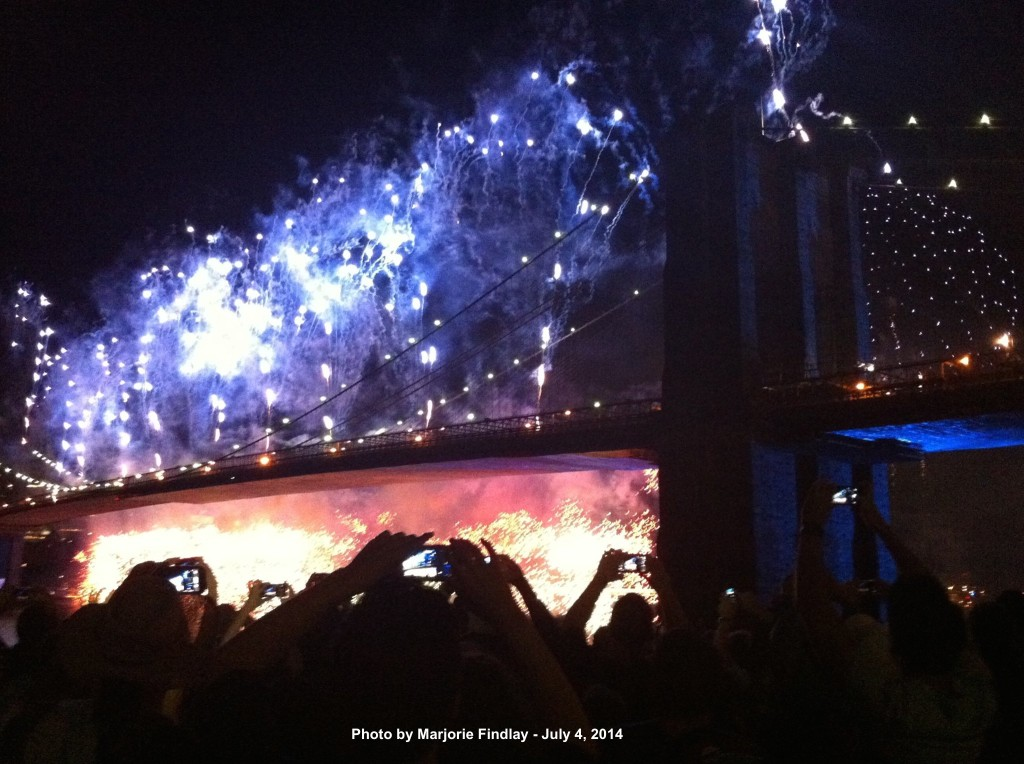Patriotic colors flood the Brooklyn Bridge in a spectacularly illuminating display. Photo courtesy of Marjorie Findlay.