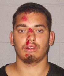 Francisco Torres of Camden after assaulting a woman in Hopatcong and then Hopatcong Police Sgt. Magrini. Photo courtesy of the Hopatcong Police Department.