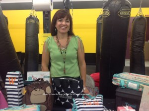 Thirty-One Consultant Stacy Walsh with her items showcased. Photo by Jennifer Jean Miller.