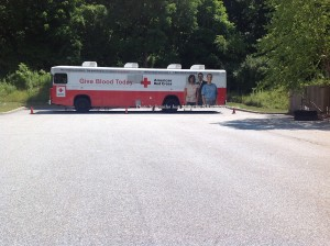The vehicle in the rear of the parking lot where the blood donations took place. Photo by Jennifer Jean Miller.