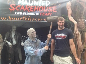 Jeff Perosi (left) gets a knock on the head from one of the actors with The Haunted Scarehouse. Photo by Jennifer Jean Miller.