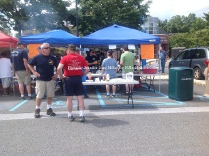 The Newton Fire Department serving up items off the grill. Photo by Jennifer Jean Miller.
