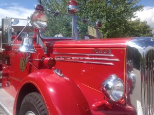 Newton's 1948 Mack Engine, equipped with antique ladders, fire extinguishers, and more. Photo by Jennifer Jean Miller.