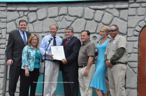 Senate and Assembly members pose with Chris and Maria Maier after presenting their business with the proclamation. Photo by Jennifer Jean Miller.