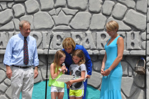 Chris and Maria Maier flank Acting Governor Kim Guadagno (center) and Molly McHose (left) and Cameron Ecke (right), as they read a letter from Governor Chris Christie. Photo by Jennifer Jean Miller.