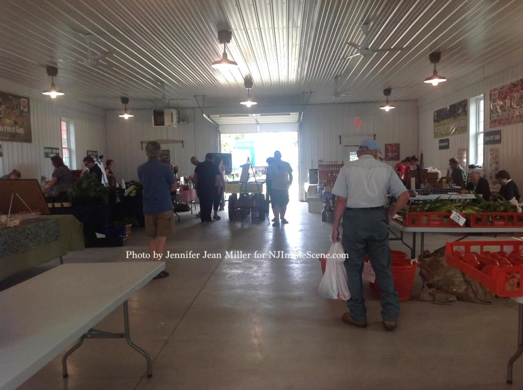 Shoppers browse the farmers market on Saturday, August 16. Photo by Jennifer Jean Miller.